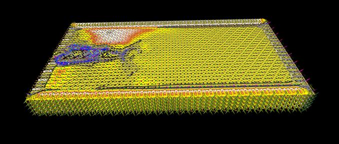 Ein aus energetischen Gründen abbiegender Riss. Neben den Dipolmomenten sind die Druckwellen mit der Visualisierungssoftware MegaMol visualisiert.